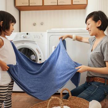 mother daughter folding towel