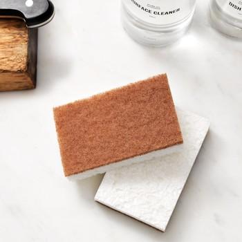 orange and white sponge on countertop