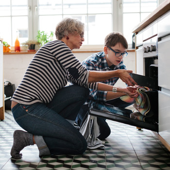 woman baking with grandson