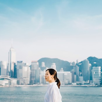 woman standing against Hong Kong city skyline