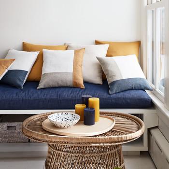blue orange and white color block throw pillows
