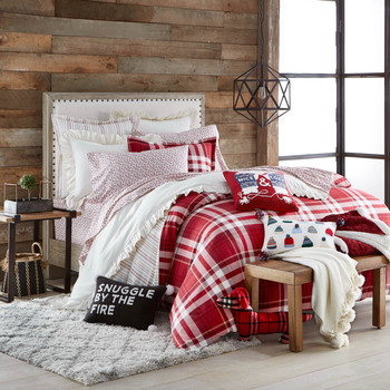 red plaid bedding with decorative holiday throw pillows