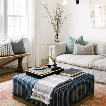 southern california house sitting room with blue ottoman