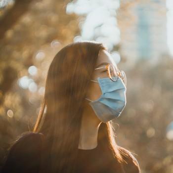 woman wearing a face mask in sunshine