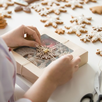 confectioner hands wrapping a box