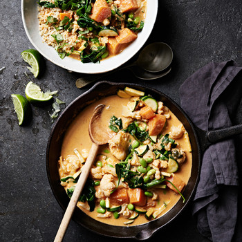 cauliflower-sweet potato curry served with cilantro and lime