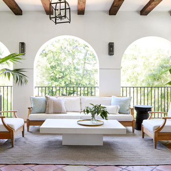 Veranda with archway door, couches, and chairs