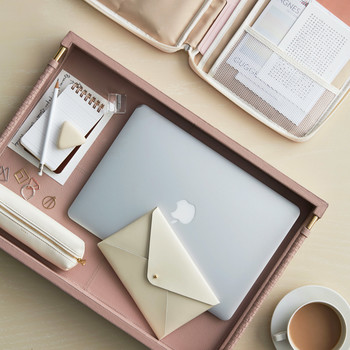 pink tray with office equipment and supplies
