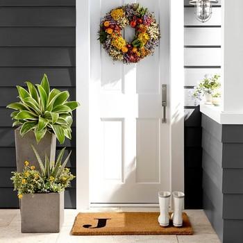 summer wreath hanging on white front door