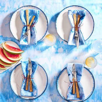 overhead view of blue and white ice dyed table setting