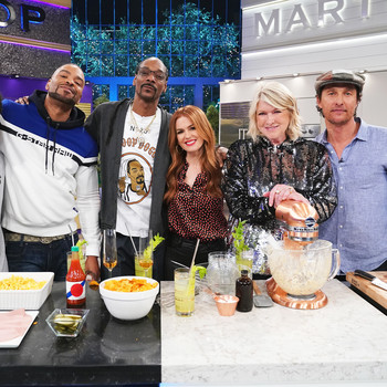 Martha Stewart and Snoop Dogg on the set of their show.