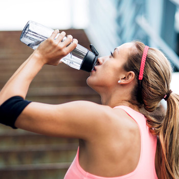 woman exercising drinking water