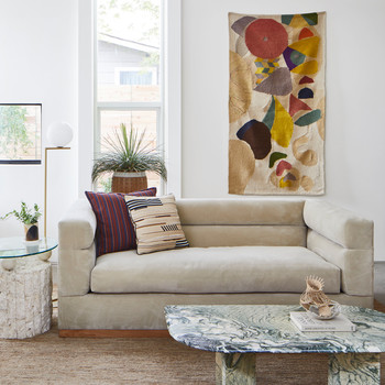 neutral-colored living room with colorful textile accent pieces