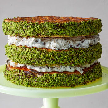layered cannoli cake on green stand