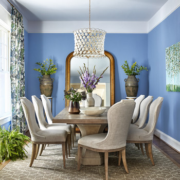 lavender-blue dining room decorated with greenery