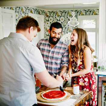 guests making pizza dinner party