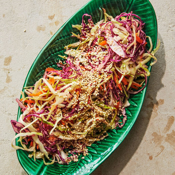 shredded cabbage with ginger vinaigrette topped with sesame seeds