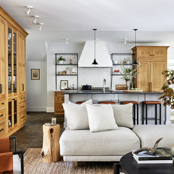 open concept living room and kitchen in neutral tones with light wood
