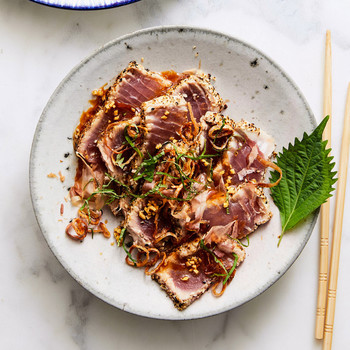 Sesame-Crusted Tuna Tataki on plate next to chop sticks