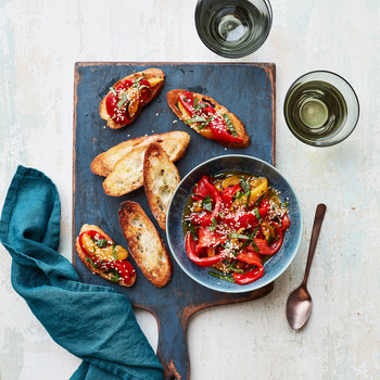 Marinated Peppers With Mint and Sesame on blue cutting board