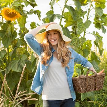 happy woman gardening in sunhat