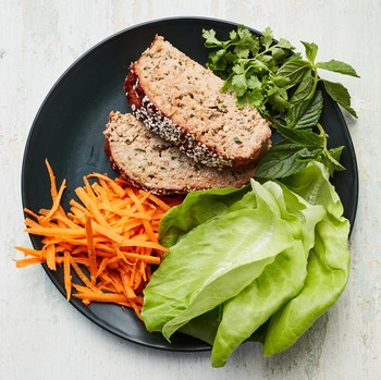 turkey meatloaf with hoisin glaze plated with lettuce carrots and herbs