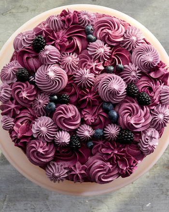 overhead of purple frosted berry layer cake