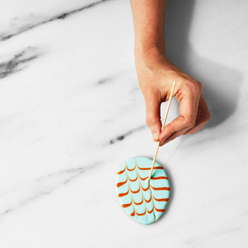 martha using toothpick to draw chevron pattern on cookies