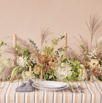 tablescape with patterned linen and floral centerpiece