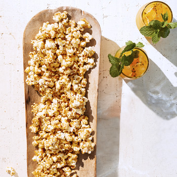 coconut-carmel popcorn served in a wooden dish