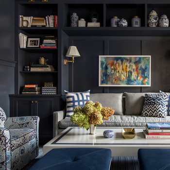 dark blue themed room large wall bookshelf