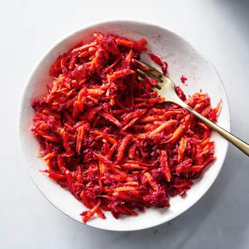 carrot beet horseradish sauce in white bowl