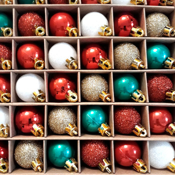 green red gold and white christmas baubles on shelf