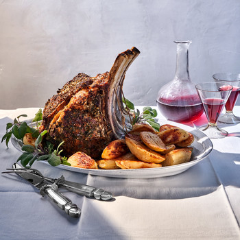 Prime Rib and Oven-Roasted Potatoes with Bay Leaves and Sage