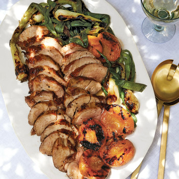 honey-glazed pork tenderloin with grilled apricots served on a white platter