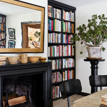 black book shelf cookbook collection fireplace