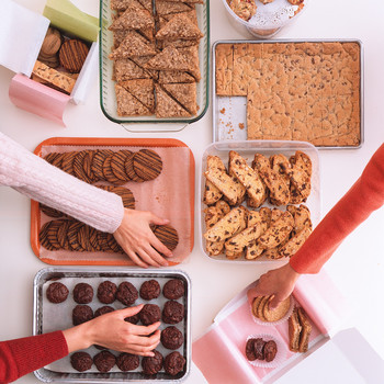 hands reaching for cookies