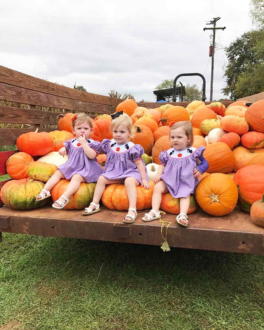 Kids Sitting on a Pumpkin Truck