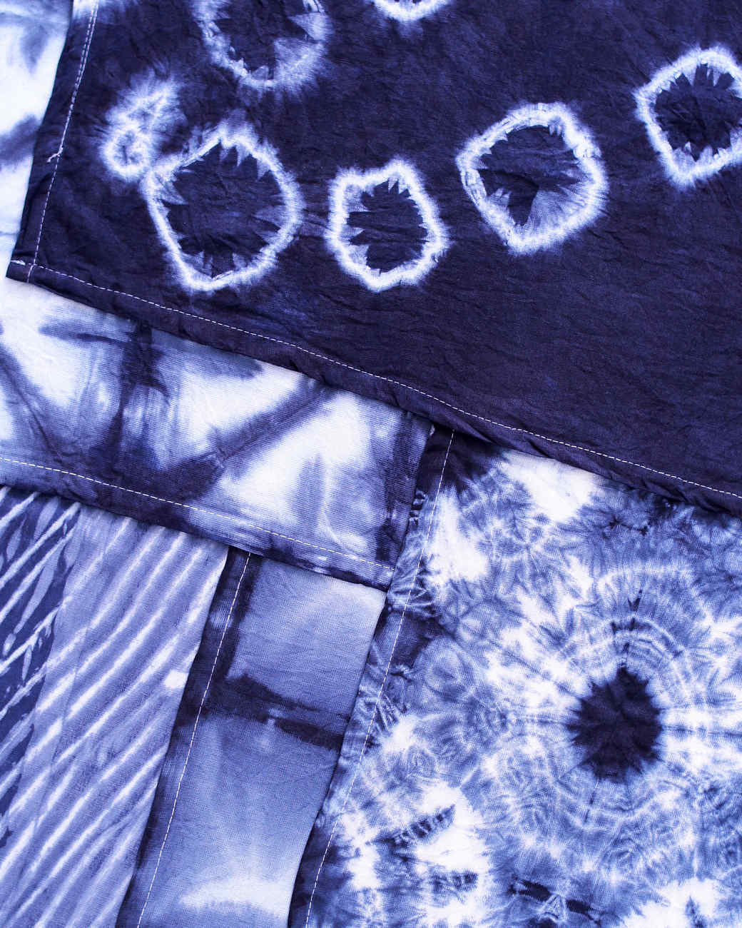 assortment of layered blue dyed fabrics