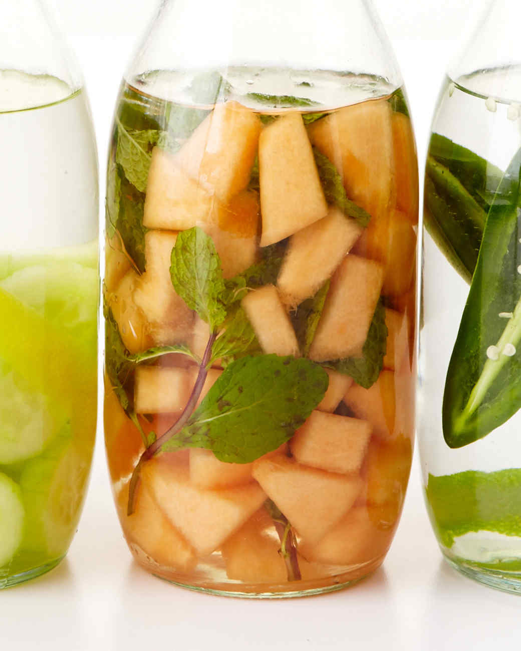 Infuse your booze liquor and cocktail recipes martha stewart mellon mint infused liquor forumfinder Image collections