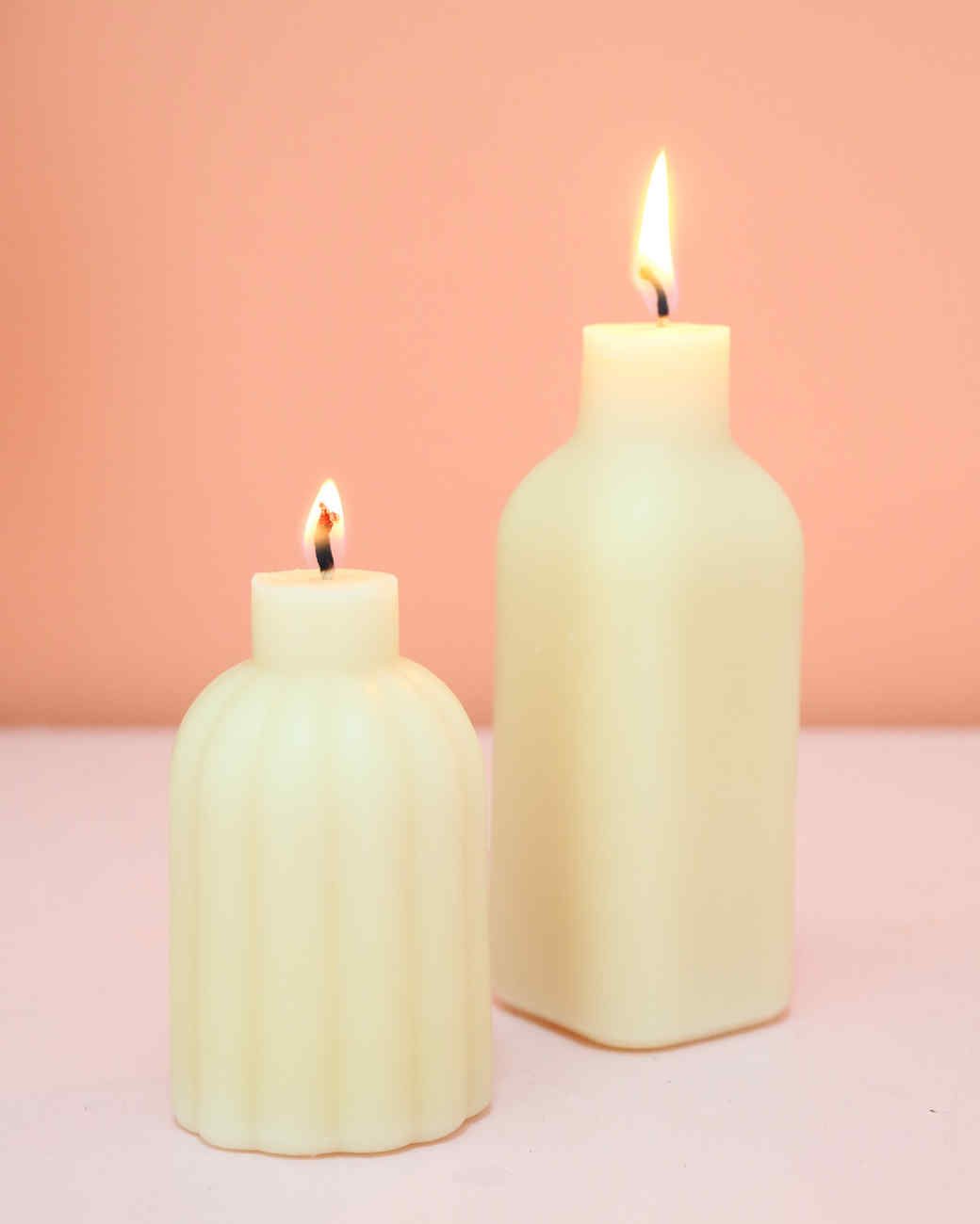 two white bottle candles lit