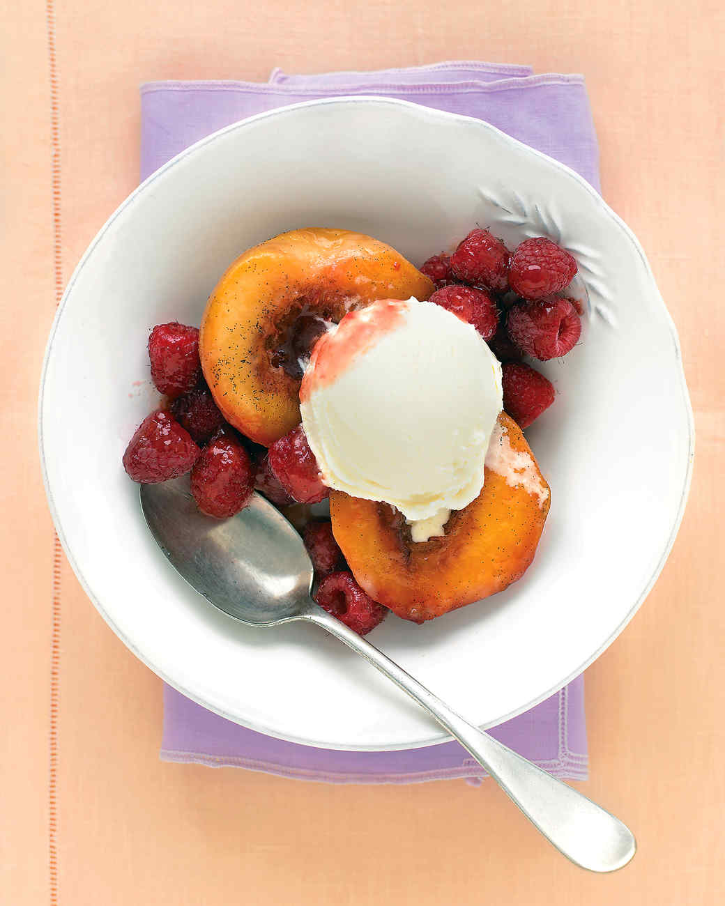 Vanilla Roasted Peaches With Raspberries Get Recipe
