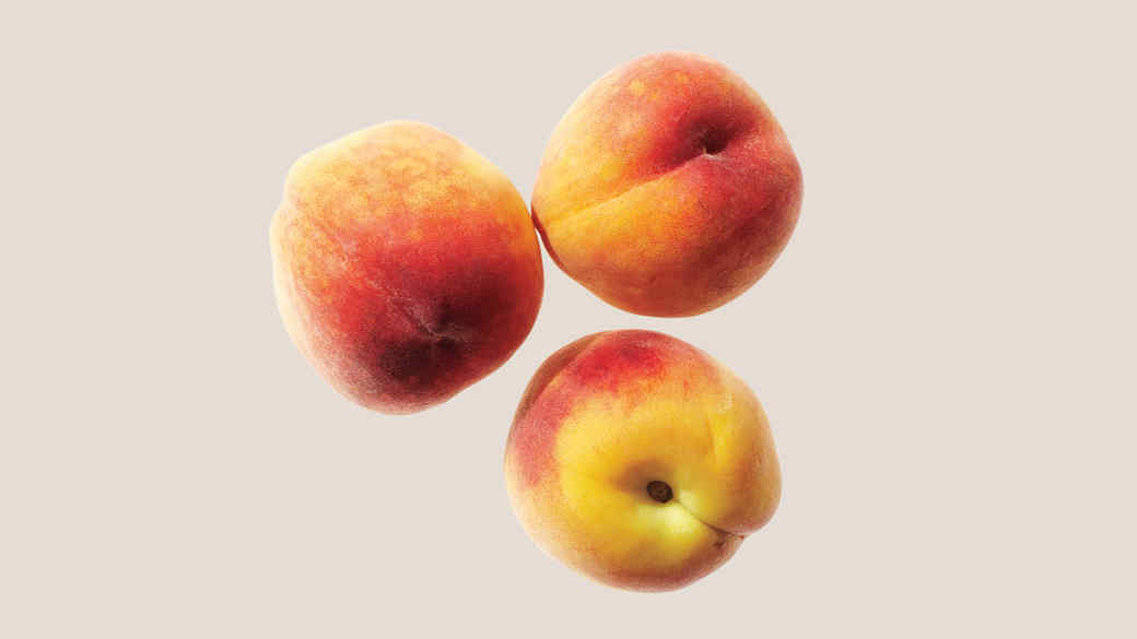 three peaches on tan background