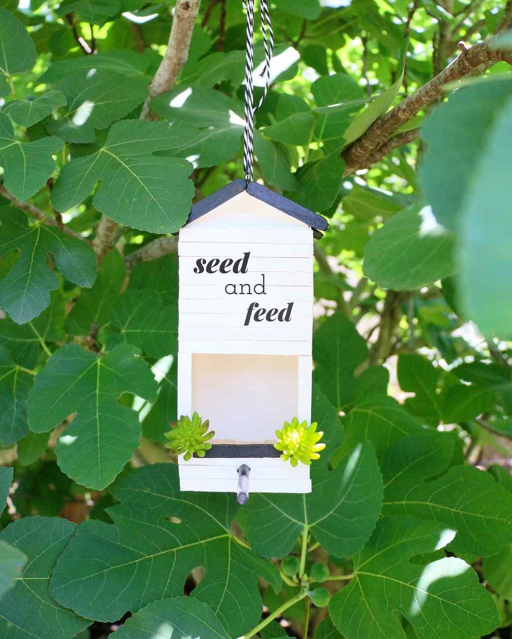 milk carton upcycled into a bird feeder