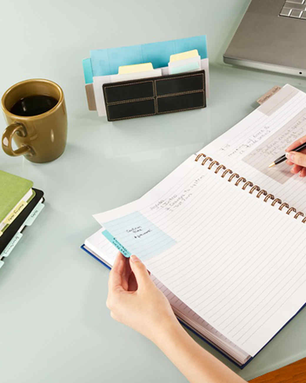 notetabs_hands_notebook.jpg