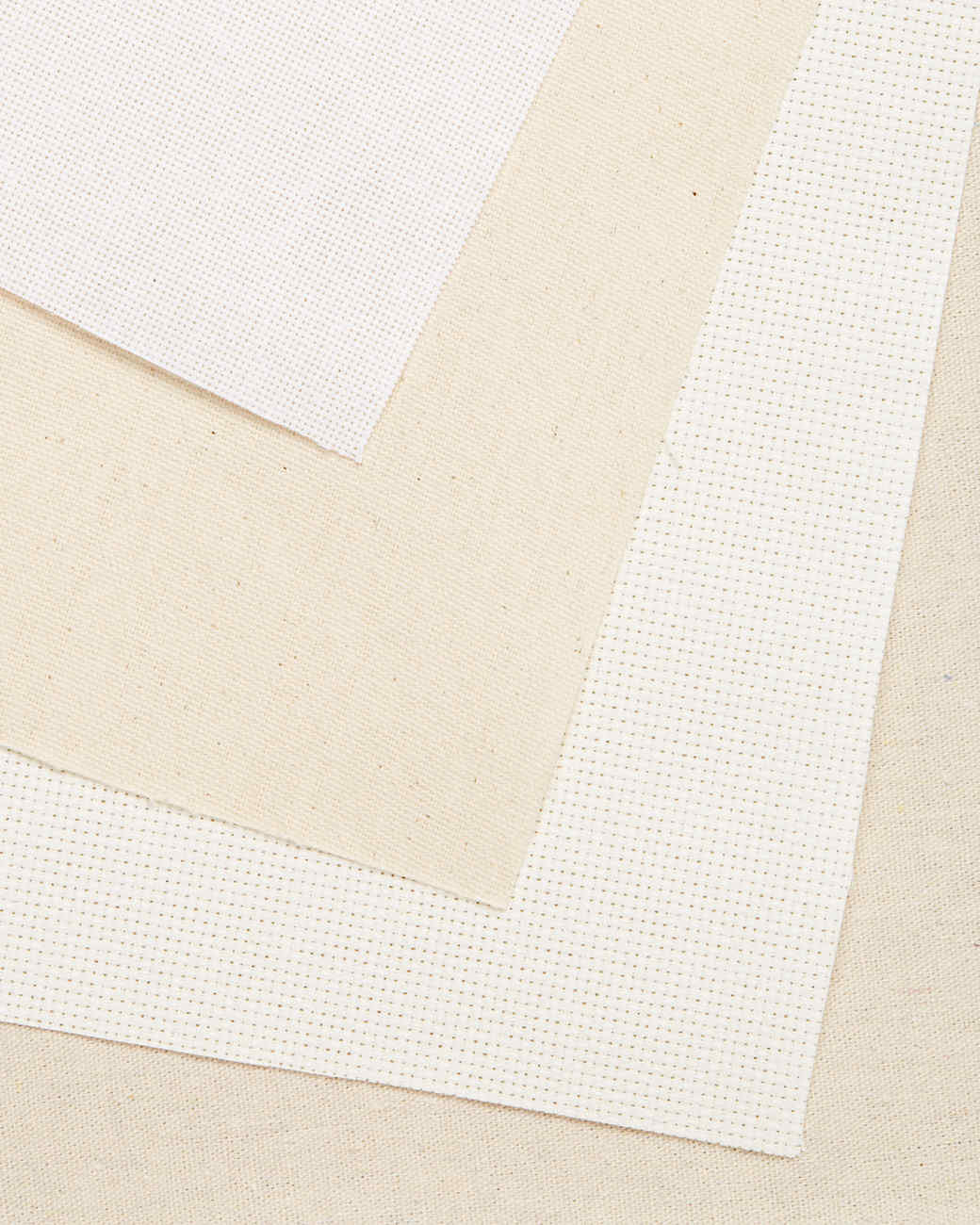 white and tan embroidery fabric