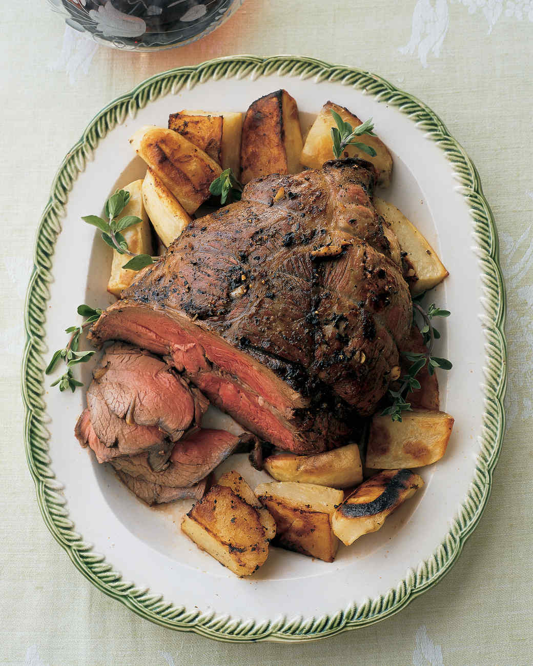 Roast Boneless Leg of Lamb with Potatoes, Lemon, and Marjoram
