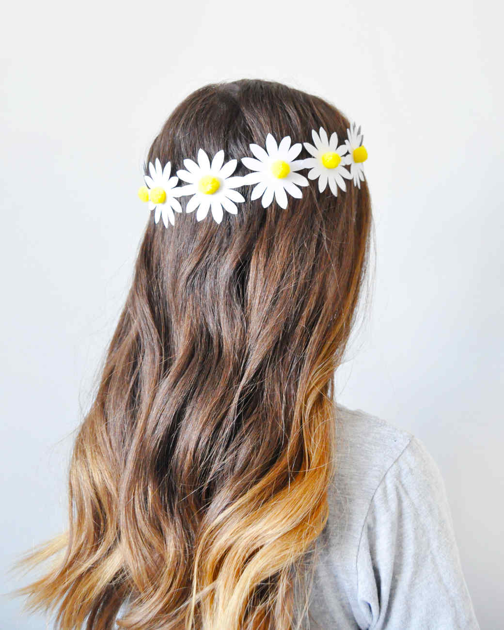daisy chain craft on woman