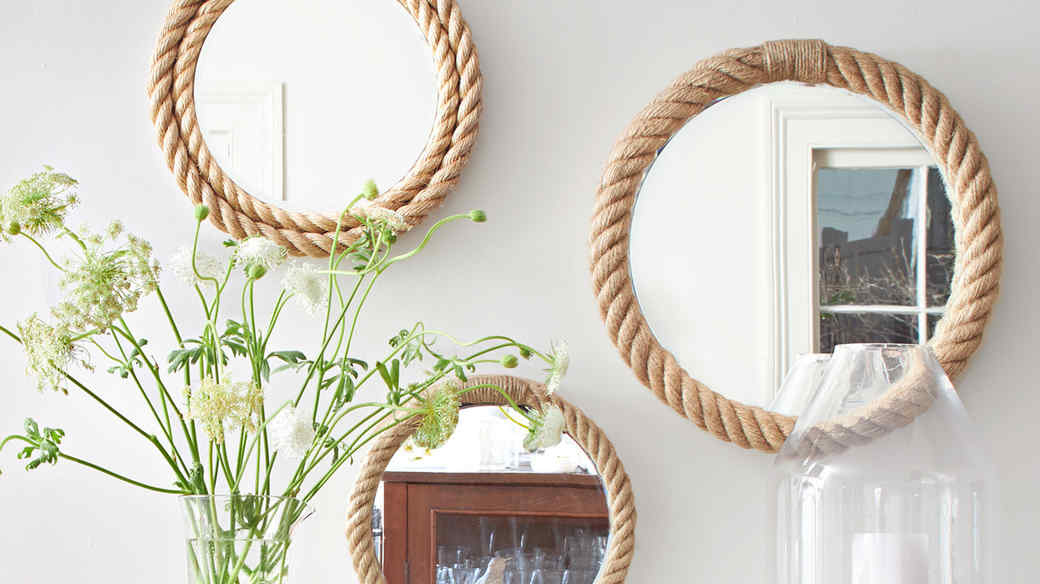 three rope mirrors arranged above hearth