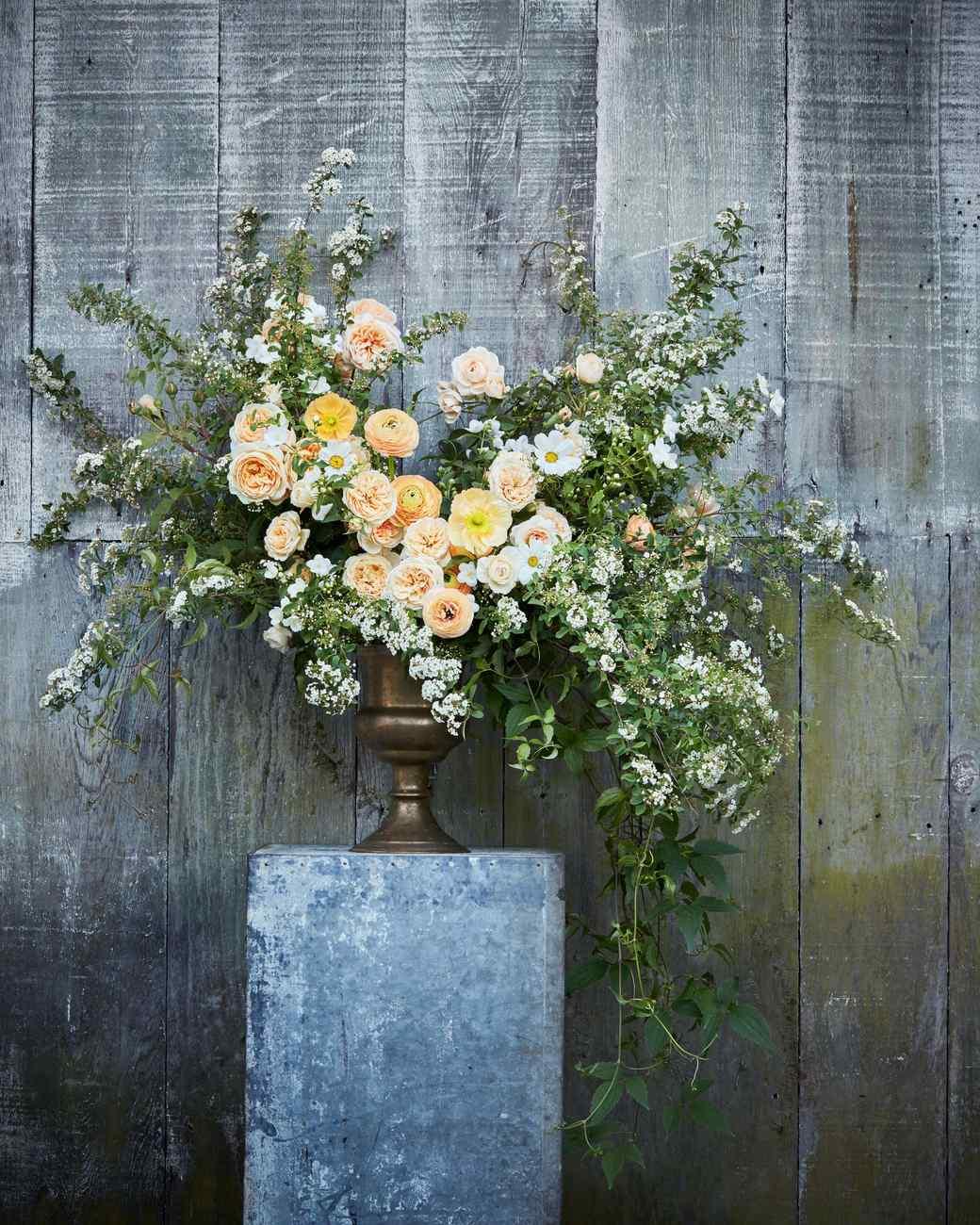 max gill floral arrangement on pedestal